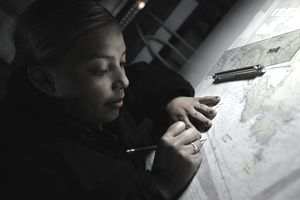 Sailor marks a map. PACIFIC OCEAN (Sept. 29, 2012) Operations Specialist Seaman Jennifer Cloud, from Houston, Texas, plots points on a map in the commanding officer's tactical operation plot compartment aboard the aircraft carrier USS Nimitz (CVN 68). Nimitz is en route to San Diego to embark Carrier Air Wing 11 as it prepares for a composite training unit exercise.