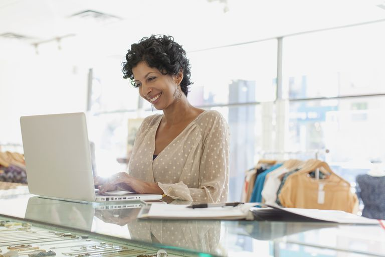 woman on laptop in retail store