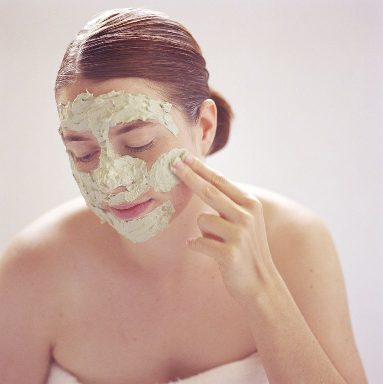 Woman with avocado face mask