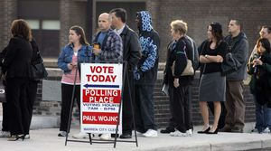 A picture of people in line to vote