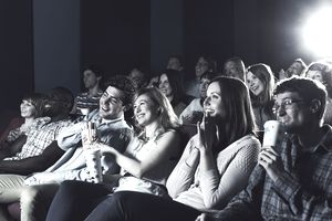 Picture of an audience enjoying a movie at a theater