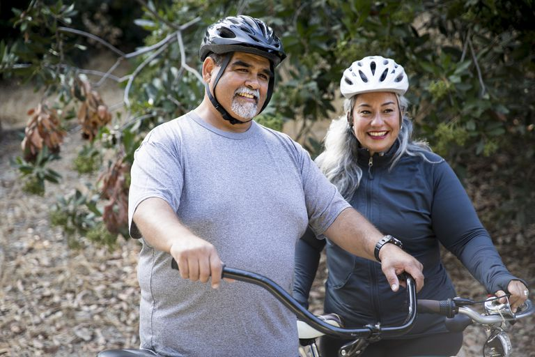 Senior Mexican couple biking
