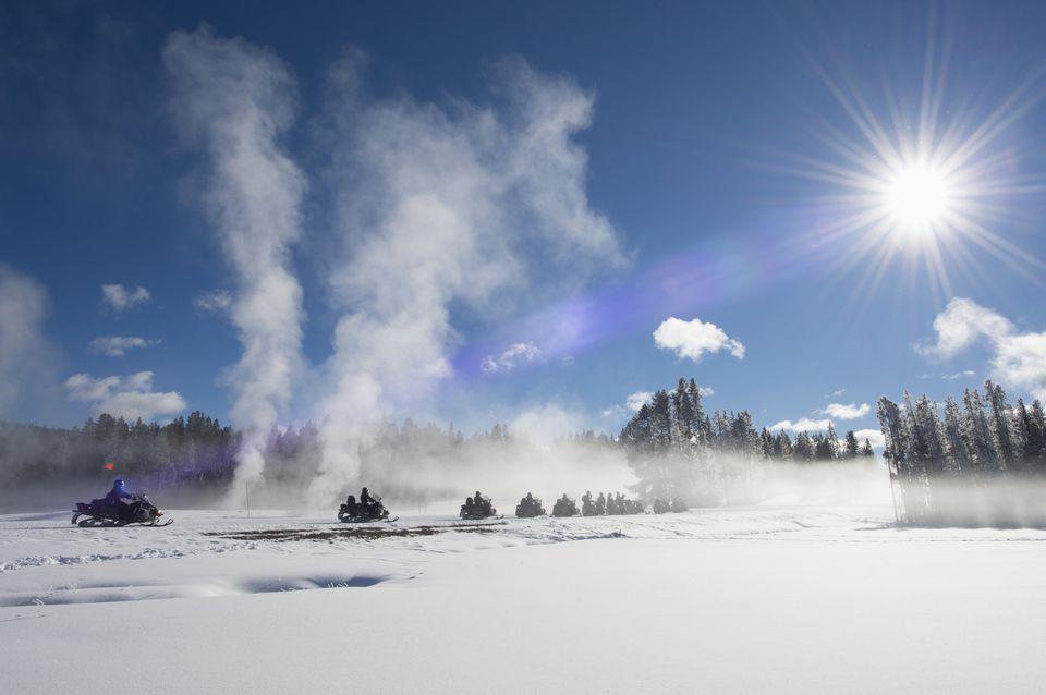 Snowmobiles riding through Fountain Flats, Yellowstone National Park.
