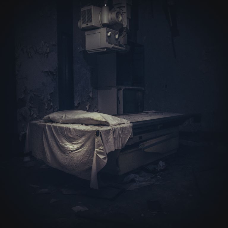 Abandoned Bed In Operating Room Of Hospital