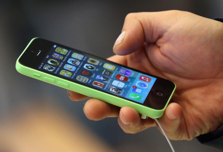 man holding iphone