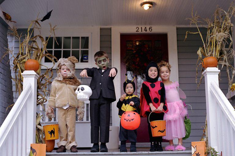 Children on porch on Halloween