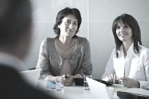 Businesswomen interviewing candidate in office