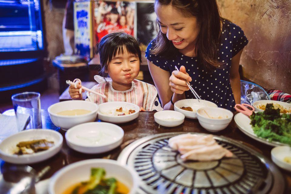Mom and daughter eating Korean dinner