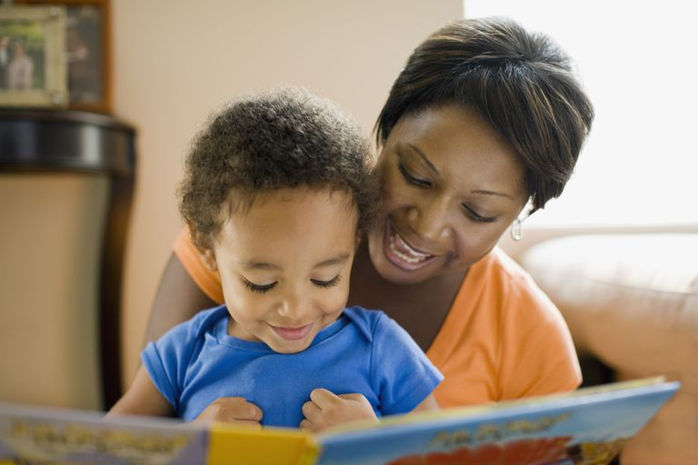 Mom reads a book to her child.