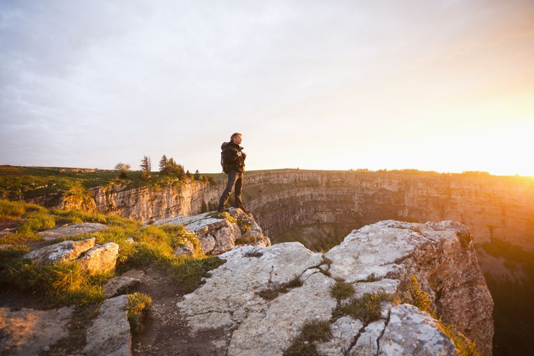 Man standing near the edge of a cliff