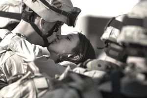 Military couple kissing