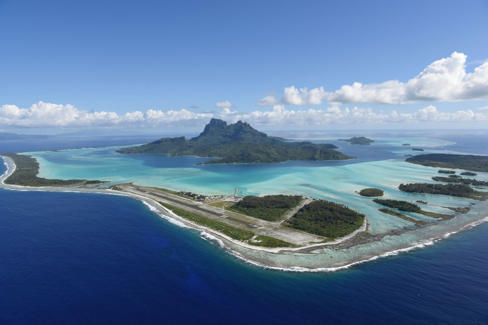 Aerial shot of Bora Bora Showing Mt. Otemanu and the Dazzling Blue Lagoon.