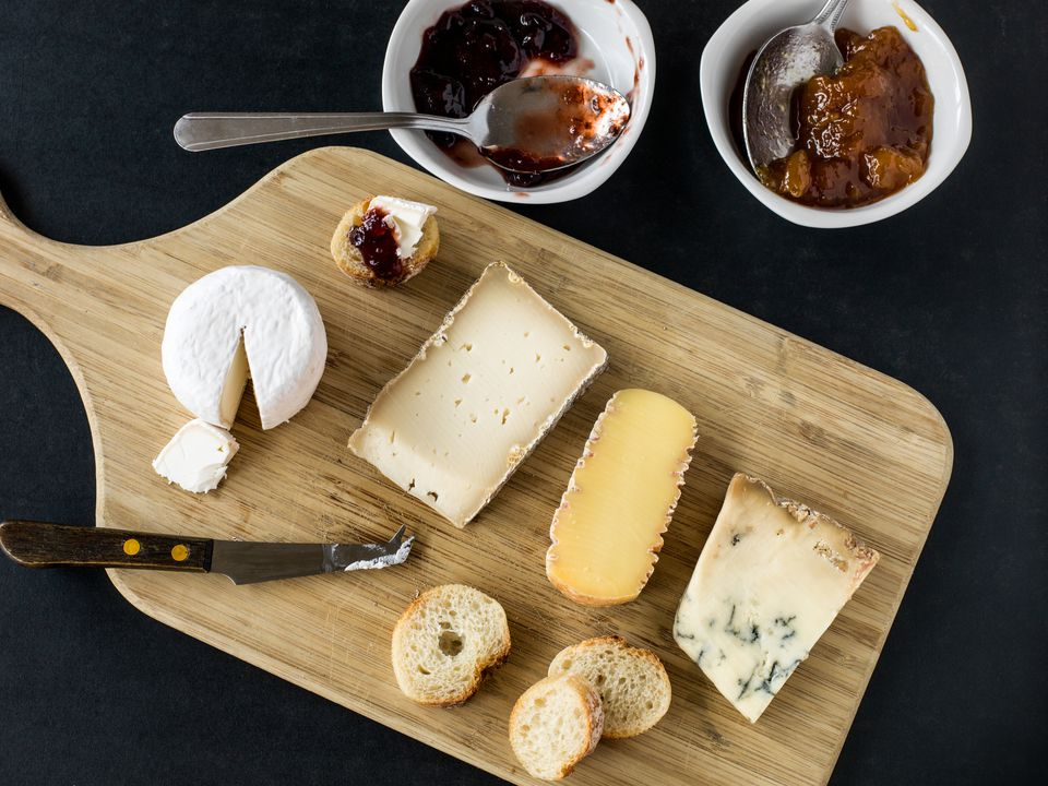 Cheese Board with Jam and Slices of Bread
