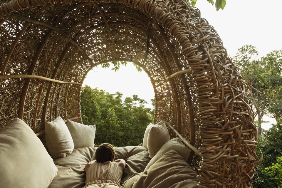 Woman laying in nest tree house