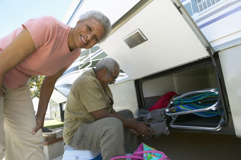 senior couple packing RV