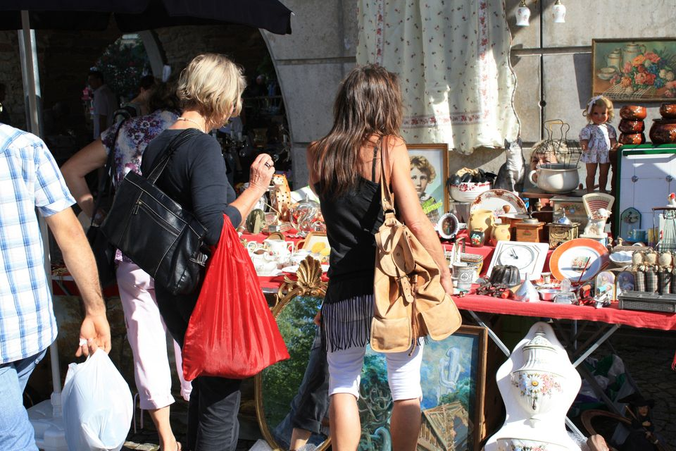 shoppers browsing vintage goods at flea market