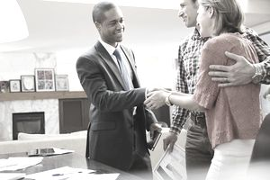 financial advisor shaking hands with clients