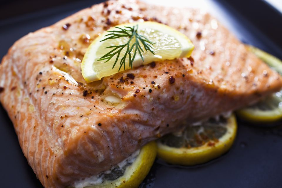 Baked salmon with a slice of lemon and some dill