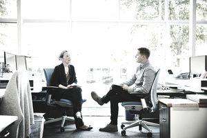 Coworkers having informal meeting
