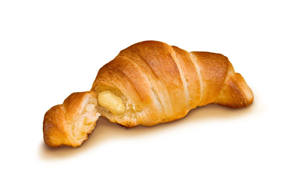 A cornetto (croissant) filled with pastry cream