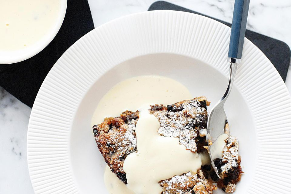 Bowl of bread and butter pudding with custard cream sauce