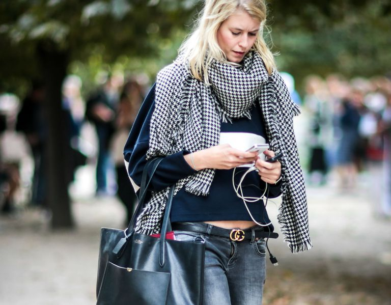 Street style woman in grey jeans and scarf