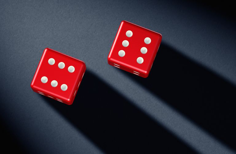 Two red dices showing six points