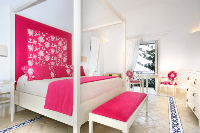 Bright pink and white master bedroom.