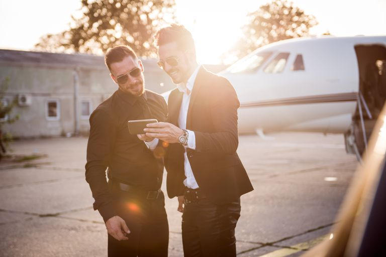 Two men in front of private jet