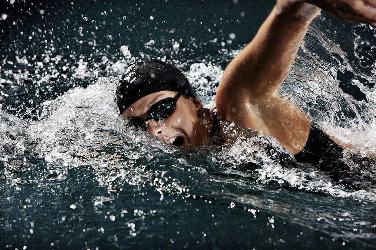 female swimmer doing crawl strokes