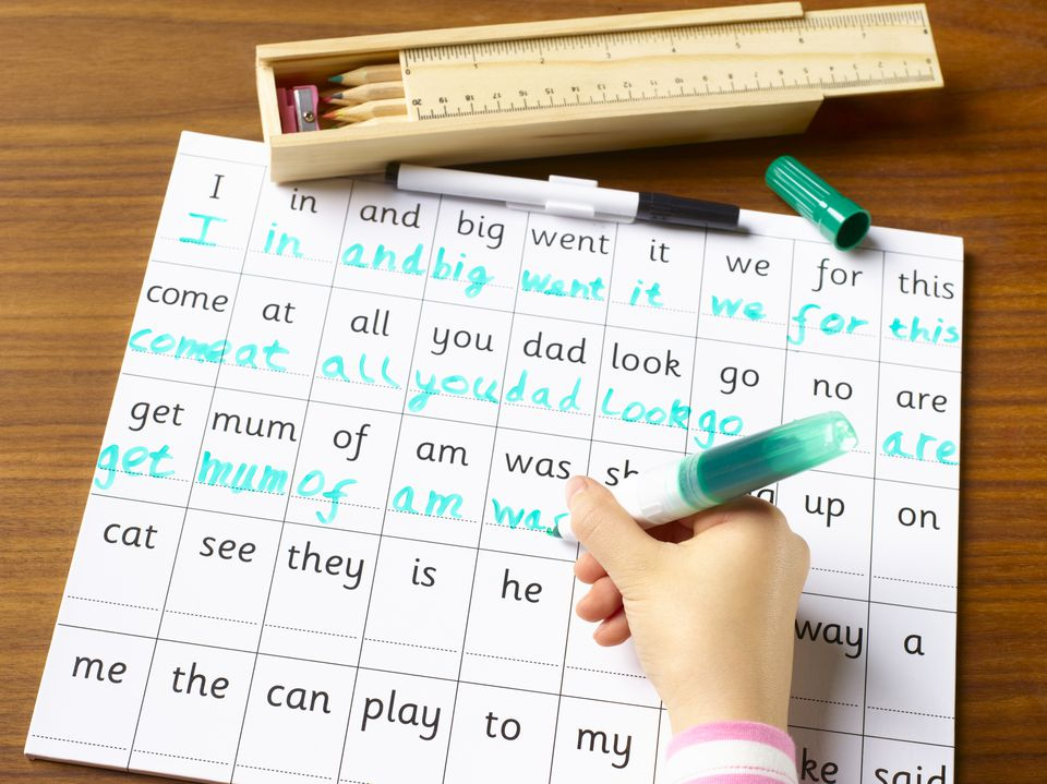 Child practicing handwritting and spelling