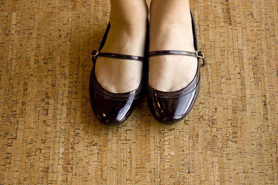 A woman's feet on a cork floor