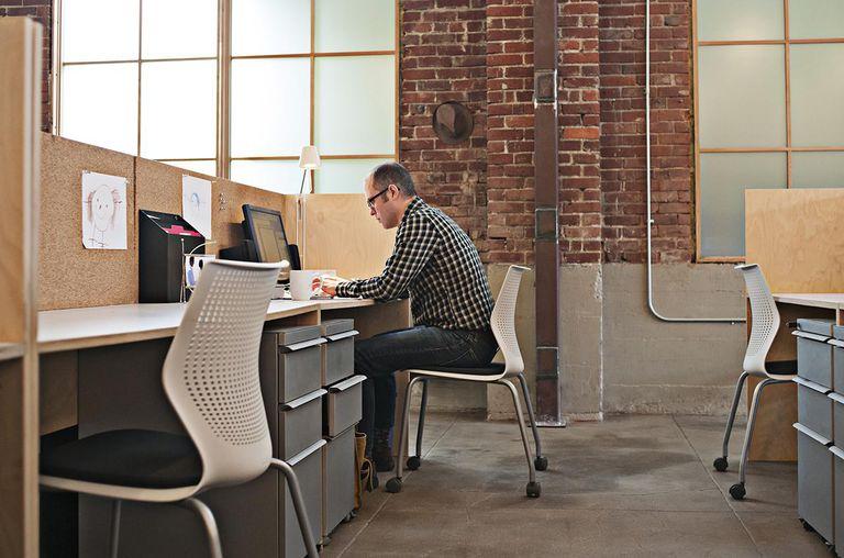 Man at desk in open plan office