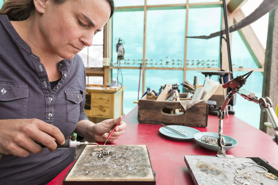 Artisan jewelry maker working in her studio
