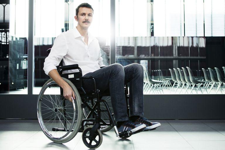 A man using a wheelchair.