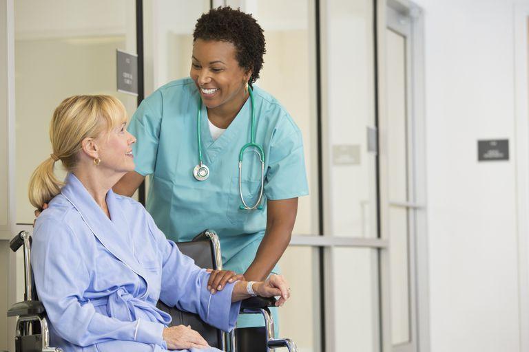 Doctor comforting patient in wheelchair