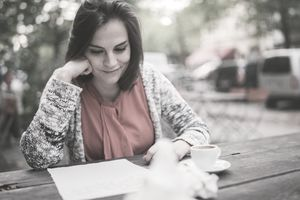 Woman reading a welcome letter