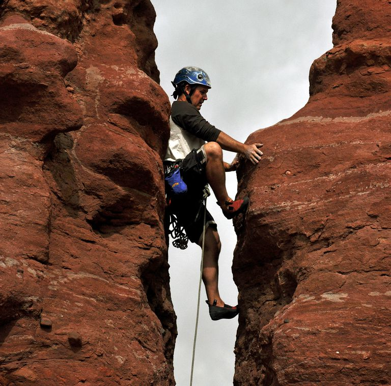Brian Shelton with Front Range Climbing Company works up a chimney on Carson's Tower at the Fisher Towers near Moab, Utah.