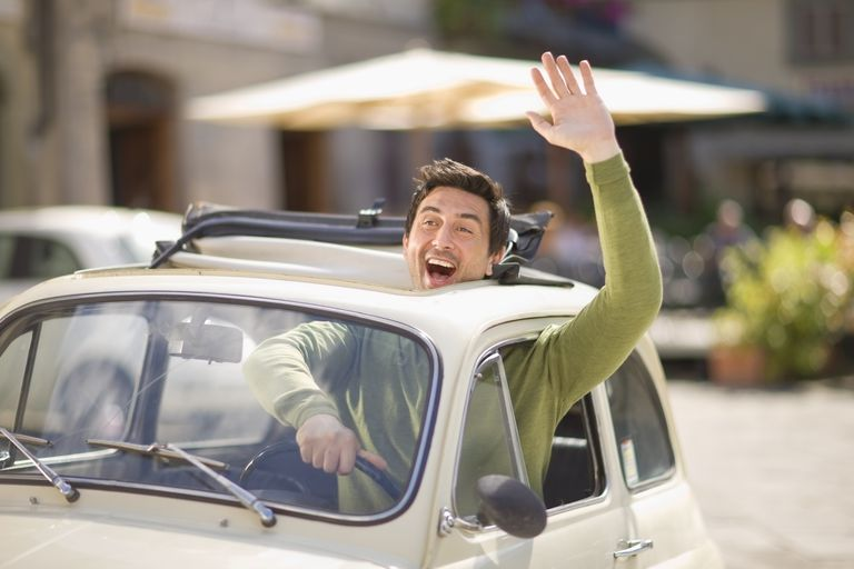 Italian man waving from Fiat