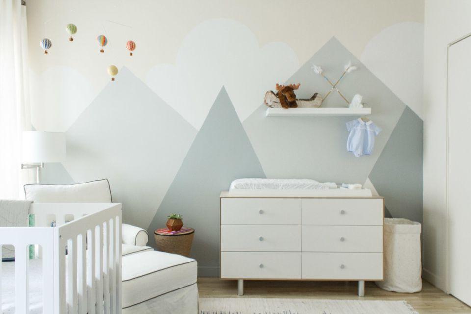 Geometric mountain mural in modern neutral nursery