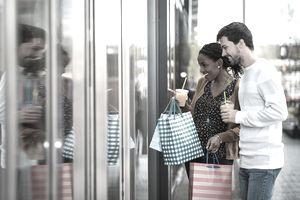 Young couple window shopping