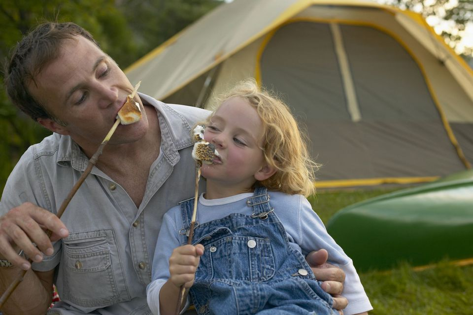 A picture of a dad and daughter camping