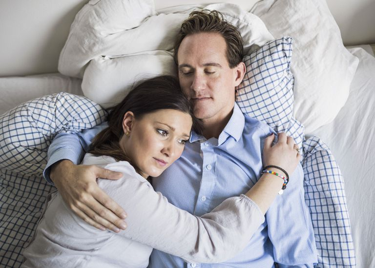 Sad couple in bed