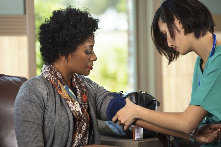 A patient has her blood pressure taken.