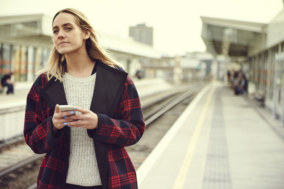 Woman waiting on train platform