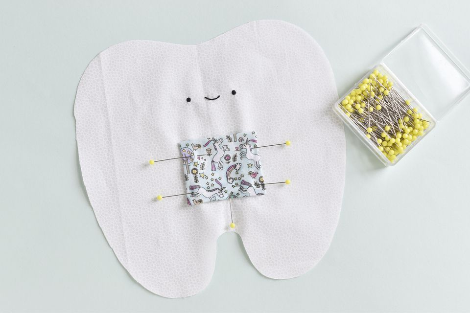 Embroider a Face and Attach the Pocket