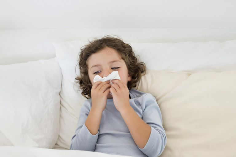 child sick in bed