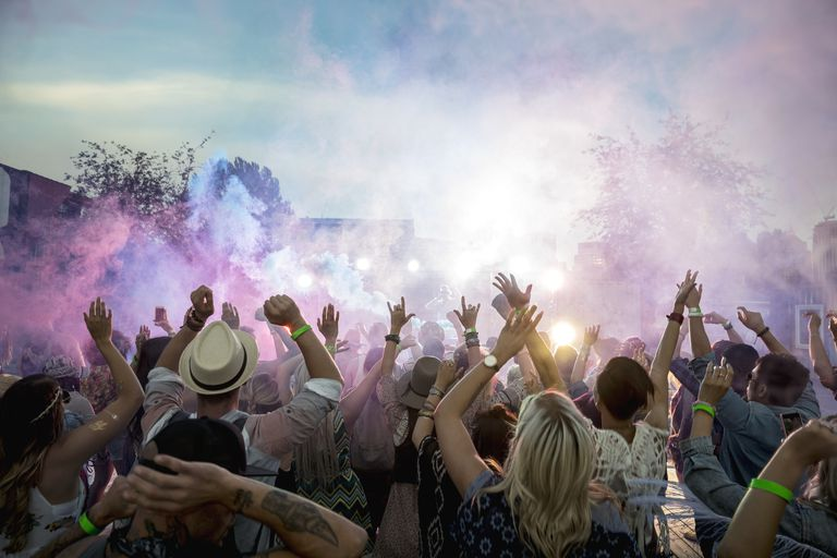 Powder over dancing crowd at summer music festival