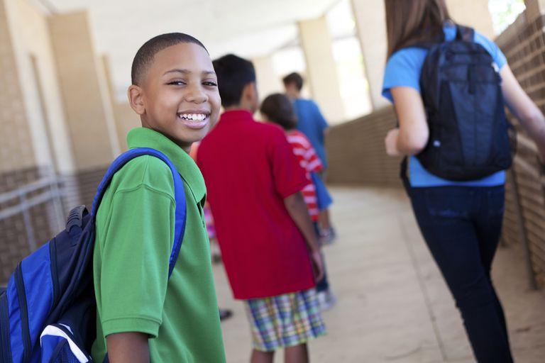 Boy in School Hallway