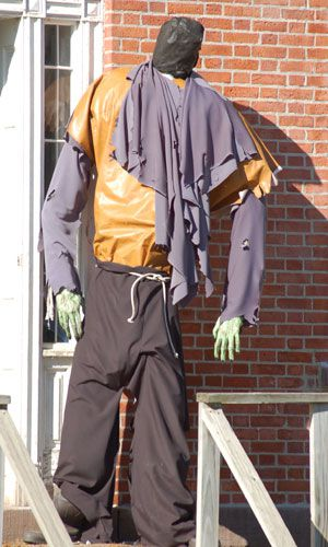 Scary scarecrow image. With executioner's hood, this scary scarecrow is the very image of fright.